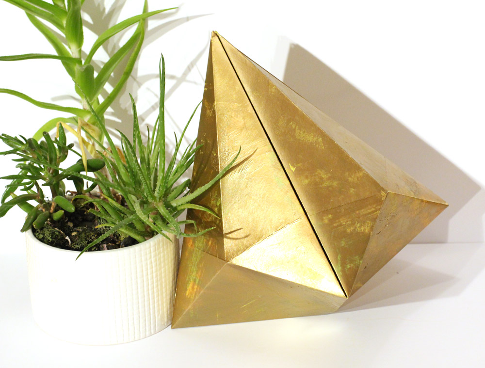 gold paper bell decoration with succulent