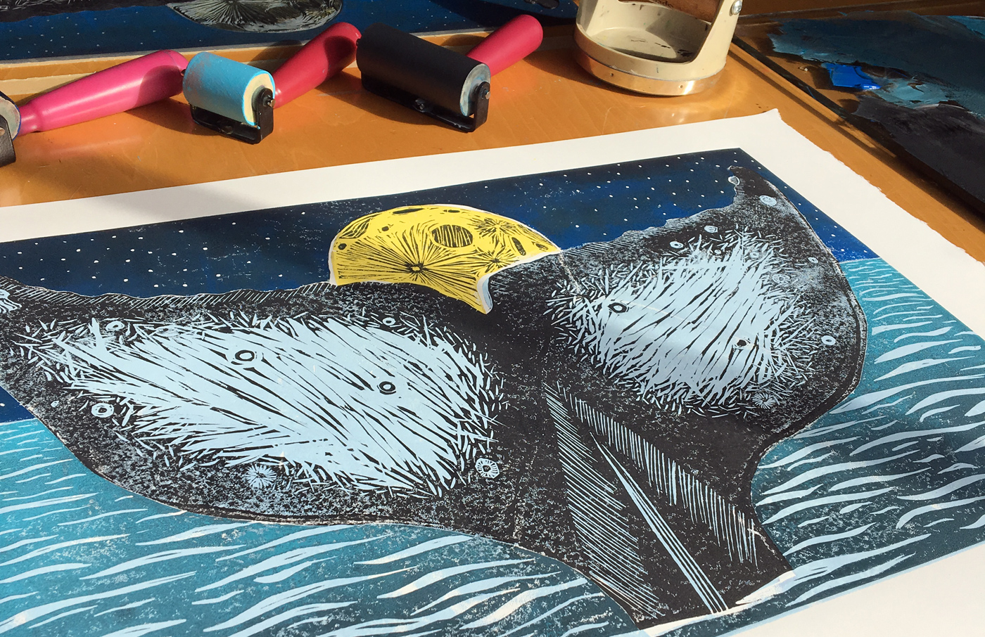 moon whale tail linocut block print artistic process